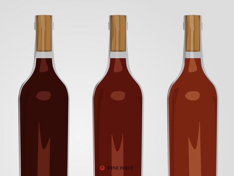 一瓶红葡萄酒在氧化过程中颜色慢慢变淡,并且发展出褐色